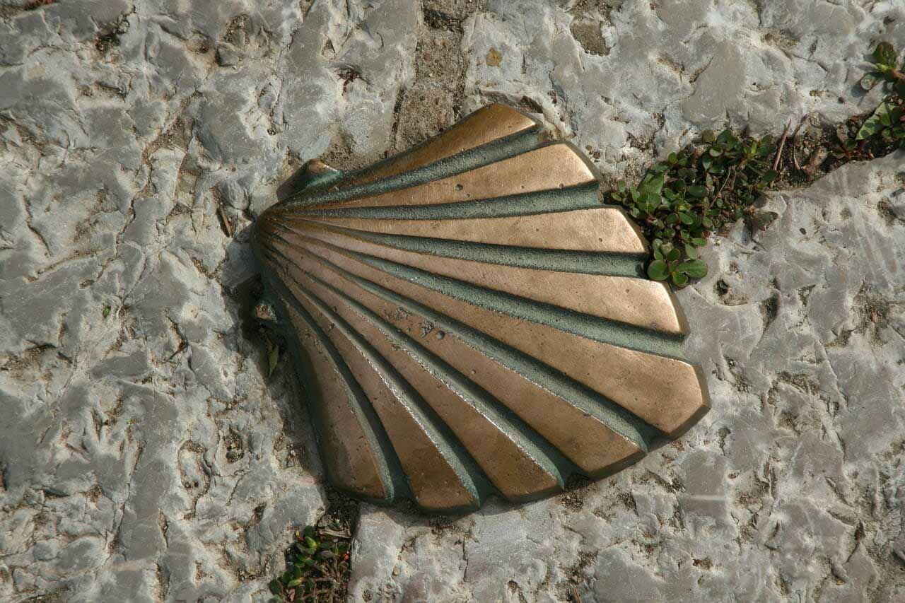Scallop shell marker on the cobble stone streets of Santiago de Compostela leading to the cathedral