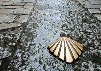Scallop shell Camino marker leading to The Cathedral de Santiago de Compostela