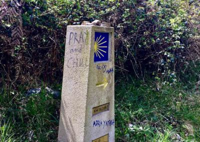 Camino Marker and uplifting graffiti.