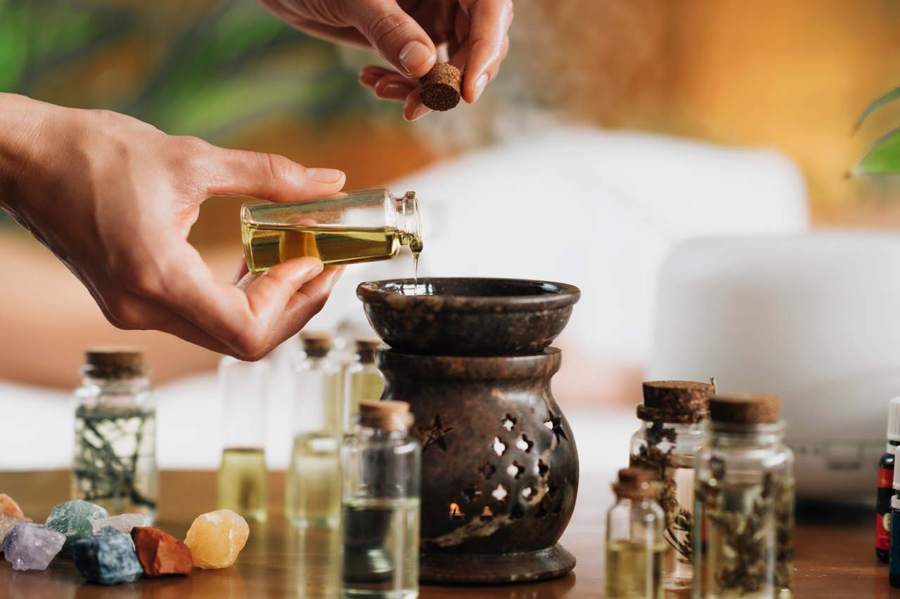 ayurveda-aromatherapy-massage-pouring-aromatic-oil